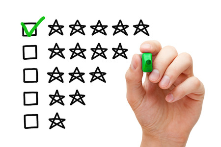 testimonial: Hand putting check mark with green marker on five star rating.