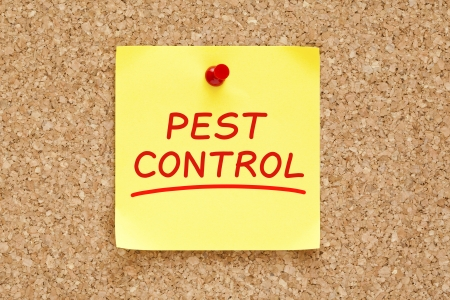 pest control: Pest Control on yellow sticky note pinned with red push pin on cork board.