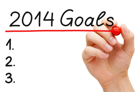 Hand underlining 2014 Goals with red marker isolated on white. photo