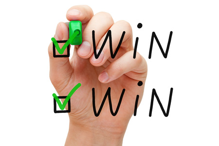 tickbox: Hand putting check mark with green marker on Win Win. Stock Photo