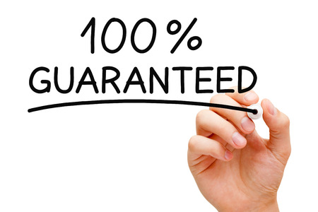 assurance: Hand writing 100 Percent Guaranteed with black marker on transparent wipe board. Stock Photo