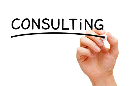 Hand writing Consulting with black marker on transparent wipe board. Stock Photo