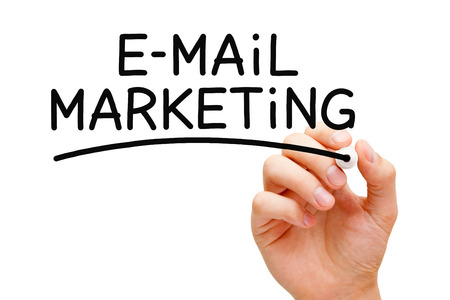 send email: Hand writing E-mail Marketing with black marker on transparent wipe board.