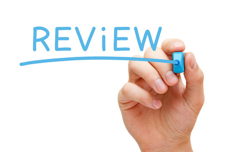review: Hand writing Review with blue marker on transparent wipe board. Stock Photo
