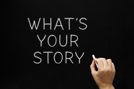 narration: Hand writing Whats Your Story question with white chalk on a blackboard.