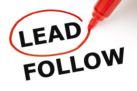 superiority: Choosing Lead instead of Follow. Lead selected with red marker. Stock Photo