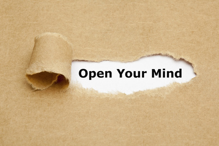 receptive: Open Your Mind appearing behind torn brown paper.  Stock Photo
