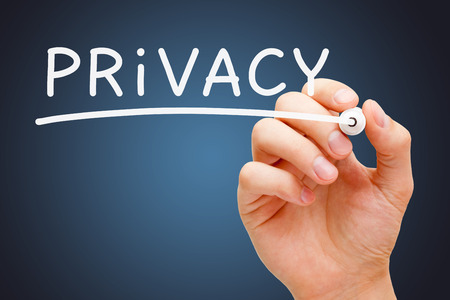 anonymity: Hand writing Privacy with white marker on transparent wipe board. Stock Photo