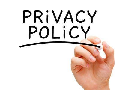 online privacy: Hand writing Privacy Policy with black marker on transparent wipe board. Stock Photo