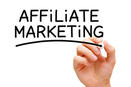 Hand writing Affiliate Marketing with black marker on transparent wipe board. photo