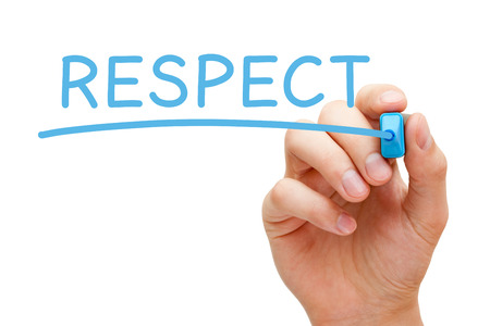 Hand writing Respect with blue marker on transparent wipe board. photo