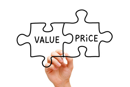 values: Hand sketching Value Price puzzle concept with black marker on transparent wipe board. Stock Photo
