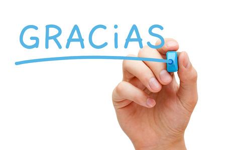 gratefulness: Mano Gracias escrito con marcador azul en Tablero transparente. Foto de archivo