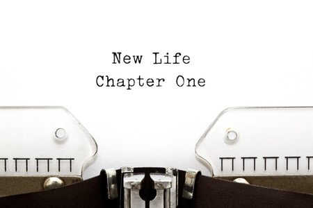 1: New Life Chapter One printed on an old typewriter. Stock Photo