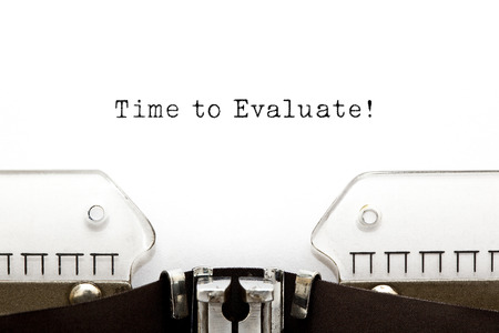 reevaluation: Time to Evaluate printed on an old typewriter. Stock Photo