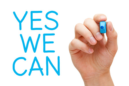 Hand writing Yes We Can with blue marker on transparent wipe board.