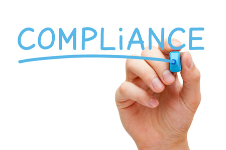 Hand writing Compliance with blue marker on transparent wipe board. Stock Photo