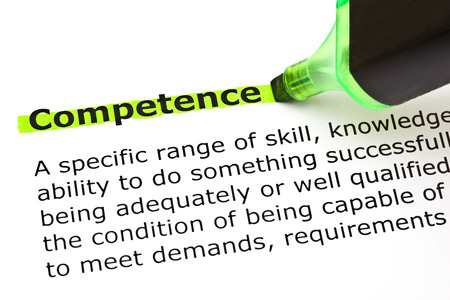 Definition of the word Competence highlighted in green with felt tip pen photo
