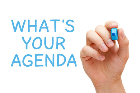 Hand writing Whats Your Agenda with blue marker on transparent wipe board. photo