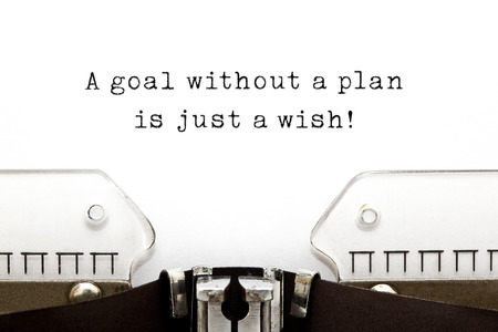 goal setting: A goal without a plan is just a wish! quote printed on an old typewriter.