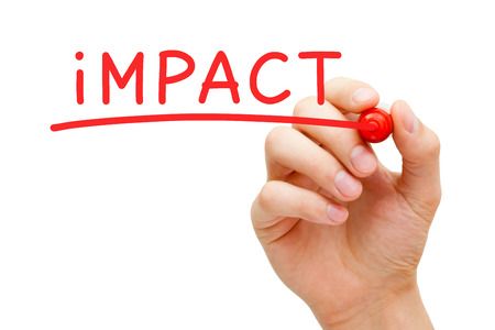 impact: Hand writing Impact with red marker on transparent wipe board. Stock Photo