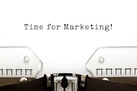 communicate concept: Time For Marketing printed on an old typewriter.