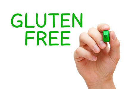 celiac disease: Hand writing Gluten Free with green marker on transparent wipe board. Stock Photo