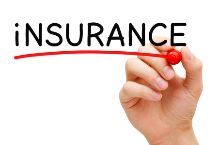 Hand underlining Insurance with red marker on transparent wipe board. photo
