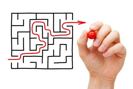 difficult to find: Hand drawing an red arrow going through a maze. Concept about finding a solution to a difficult task. Stock Photo