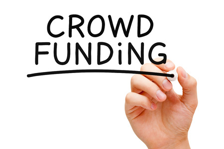 crowd sourcing: Hand writing Crowd Funding with black marker on transparent wipe board. Stock Photo