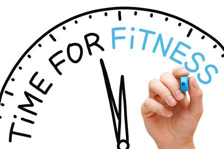 fitness training: Hand schrijven Tijd voor Fitness concept met blauwe markering op transparante veeg boord. Stockfoto