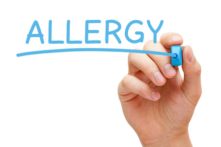 diagnosed: Hand writing Allergy with blue marker on transparent wipe board. Stock Photo