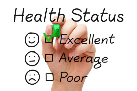evaluate: Hand putting check mark with green marker on excellent in Health Status evaluation form. Stock Photo