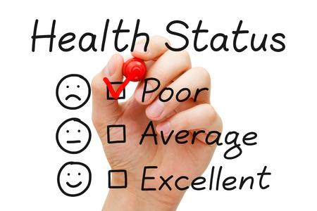 Hand putting check mark with red marker on poor in Health Status evaluation form.