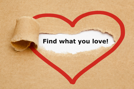 feeling happy: Find what you love, appearing behind torn brown paper. Stock Photo