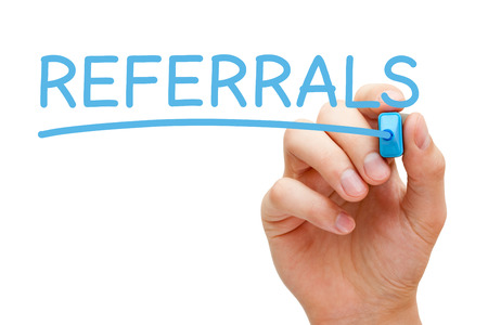 testimonial: Hand writing Referrals with blue marker on transparent wipe board.