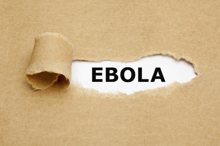 The word Ebola appearing behind torn brown paper.
