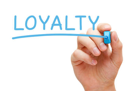 believable: Hand writing Loyalty with blue marker on transparent wipe board. Stock Photo