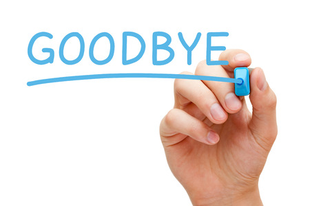 Hand writing Goodbye with blue marker on transparent wipe board isolated on white. photo