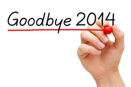 Hand underlining Goodbye 2014 with red marker isolated on white. photo