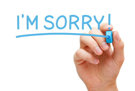 Hand writing I am Sorry with blue marker on transparent wipe board isolated on white. photo