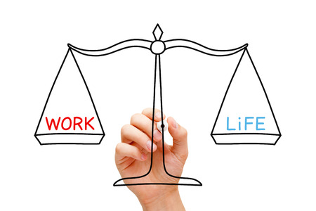 Hand drawing Work Life balance scale concept with black marker on transparent wipe board isolated on white.