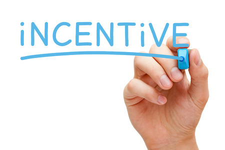 incentive: Hand writing Incentive with blue marker on transparent wipe board isolated on white.