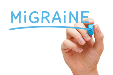 diagnosed: Hand writing Migraine with blue marker on transparent wipe board isolated on white.