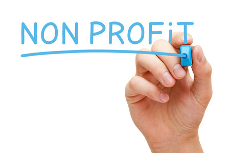 non profit: Hand writing Non Profit with blue marker on transparent wipe board isolated on white.
