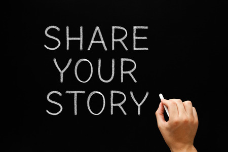 narration: Hand writing Share Your Story with white chalk on a blackboard.