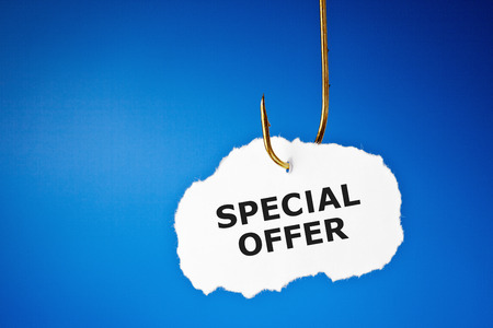 Special Offer hanging on a fishing hook over blue background. Standard-Bild