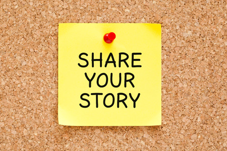 narration: Share Your Story, written on an note it note pinned on a cork bulletin board. Stock Photo