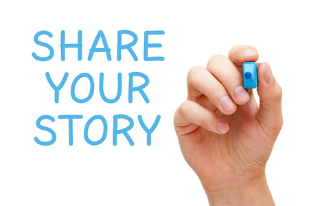Hand writing Share Your Story with blue marker on transparent wipe board.