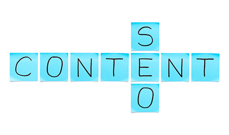 backlink: Content SEO crossword made with blue sticky notes on white background.